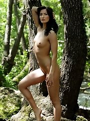 Marion loves open air nudity and she is posing nude by the river streams for us